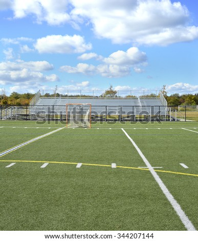 Soccer Field Bleachers Training Goal Net blue sky clouds