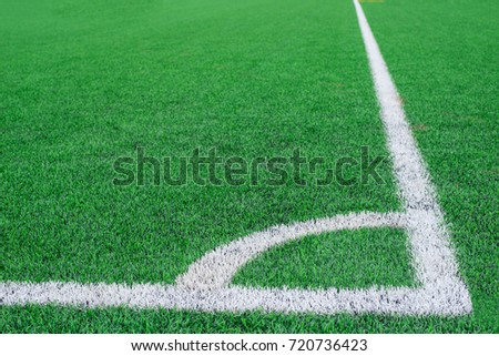 Soccer field grass conner.Beautiful pattern of fresh green grass for football sport, football field,team sport texture.