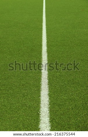 Soccer field grass on the green texture - stock photo