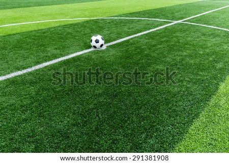 soccer field grass with ball at kick off point. - stock photo