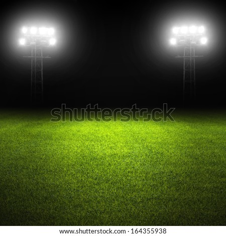 Soccer field template with grass and stadium lights - stock photo