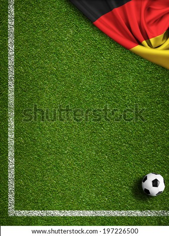 Soccer field with ball and flag of Germany