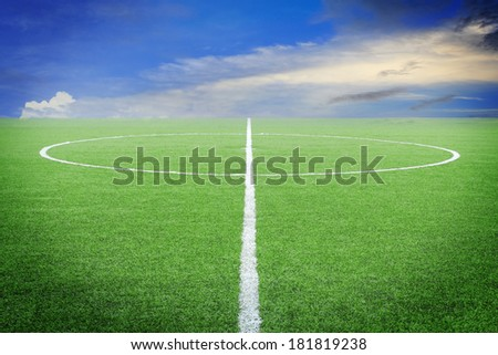 soccer field with blue sky - stock photo