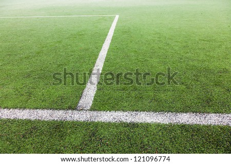 soccer field with green grass and painted white lines