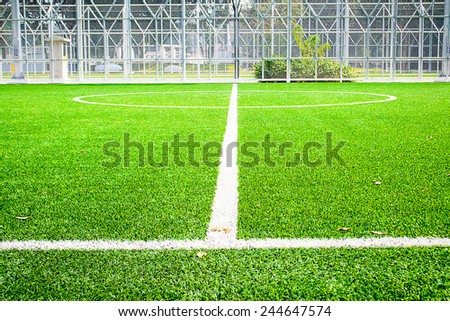 soccer field with green grass in outdoor stadium - stock photo