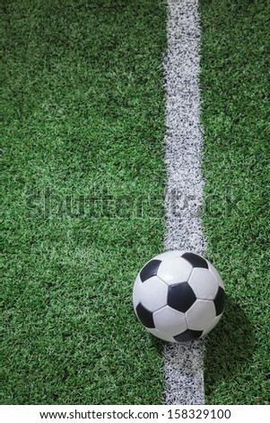 Soccer field with soccer ball and line - stock photo