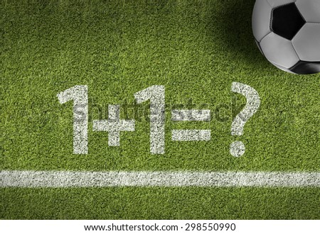 Soccer field with the text: 1+1=? - stock photo