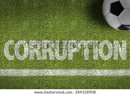 Soccer field with the text: Corruption - stock photo