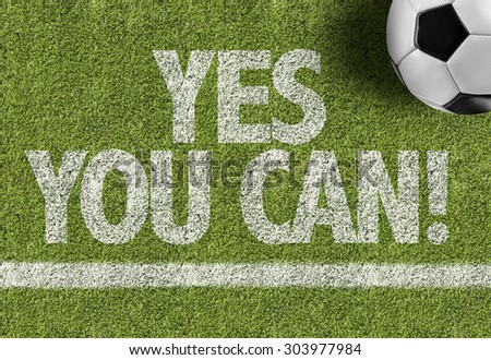 Soccer field with the text: Yes You Can! - stock photo