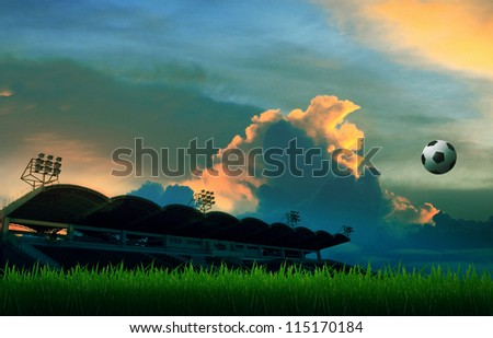 soccer football floating on air and stadium colorful sky background - stock photo