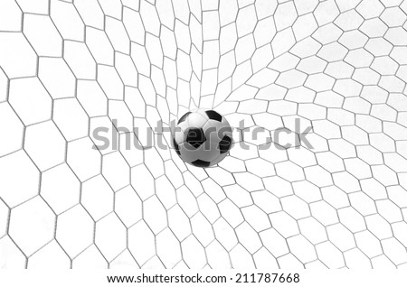 Soccer football in Goal net isolated on white with clipping path - stock photo