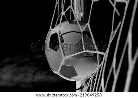 Soccer football in Goal net with sky field. Infrared.  - stock photo