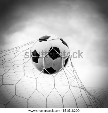 Soccer football in Goal net with the sky. For sport concept.