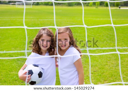 Soccer football kid girls playing on sports outdoor field - stock photo