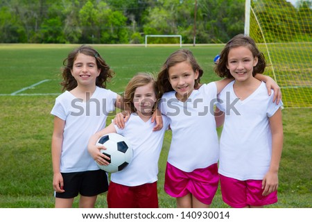 Soccer football kid girls team at sports outdoor field before match - stock photo