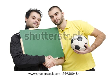 Soccer/football management, Coach and Player shaking hands, holding empty blackboard isolated on white, selective focus  - stock photo