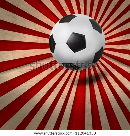 soccer football on colorful ray background - stock photo