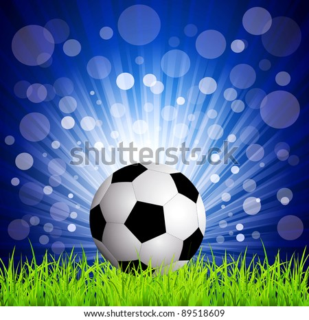 soccer football on grass, on a blue background with rays