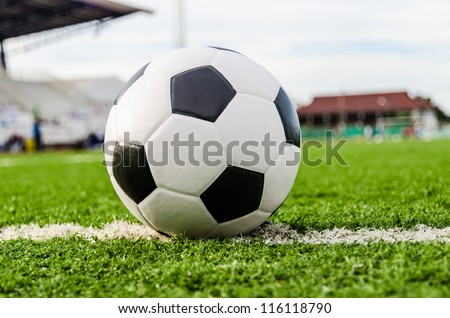 Soccer Football on line of Soccer field with player playing soccer. - stock photo