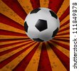 soccer football on red yellow ray background - stock photo