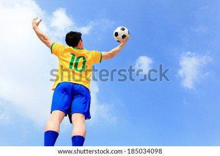 Soccer football player play ball with blue sky