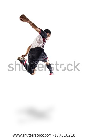 Soccer football player young man kicking, isolated on white background