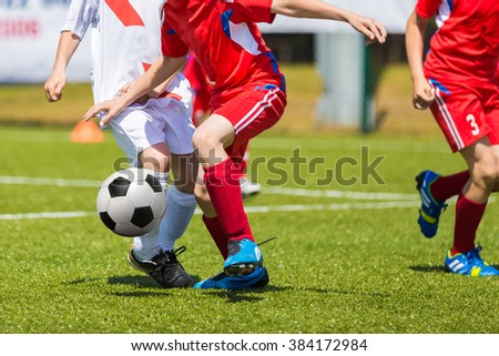 Soccer Football Teams Playing Soccer Football Training Match. Players Running and Kicking Soccer Ball. - stock photo