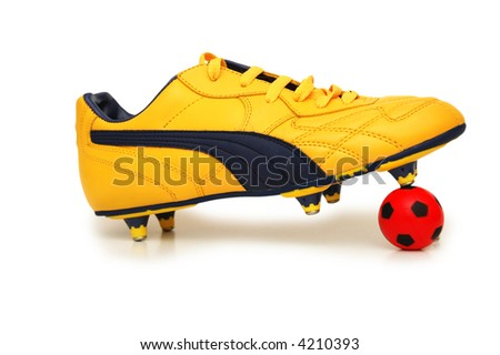 Soccer footwear and color football isolated on white