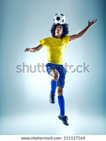 Soccer fotball player header ball with skill - stock photo