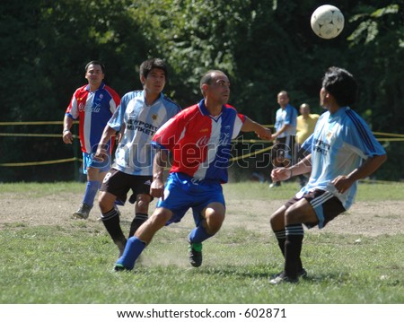 soccer game with  ball in air - stock photo