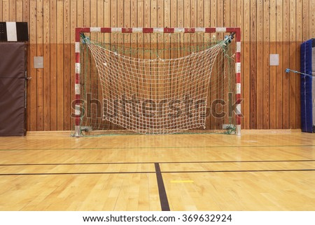Soccer goal in an old gymhall - stock photo
