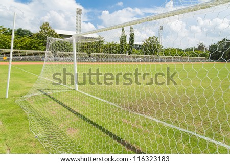 Soccer goal net in football field grass in stadium