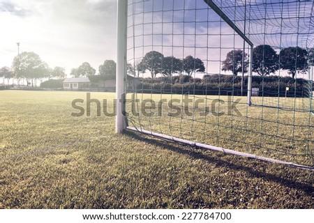 Soccer goal on summer field (football field) - stock photo