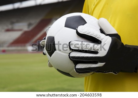 soccer goalkeeper with ball in his hand  - stock photo