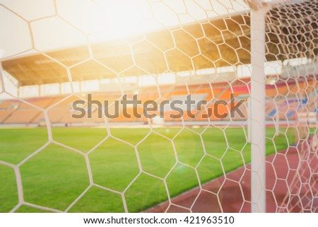soccer net  at soccer stadium on sunset.  - stock photo