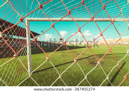 soccer net  at soccer stadium , vintage tone - stock photo