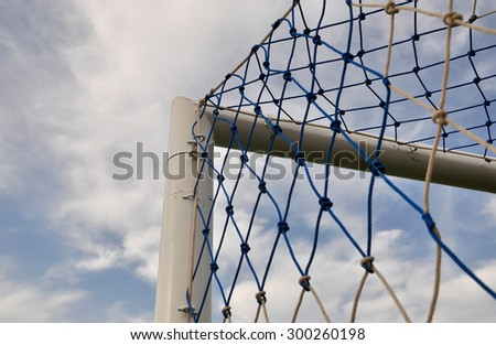 Soccer net with clear sky background - stock photo