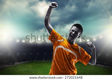 Soccer. One brazilian soccer football player young man happiness joy pointing up  in silhouette studio isolated on white background - stock photo
