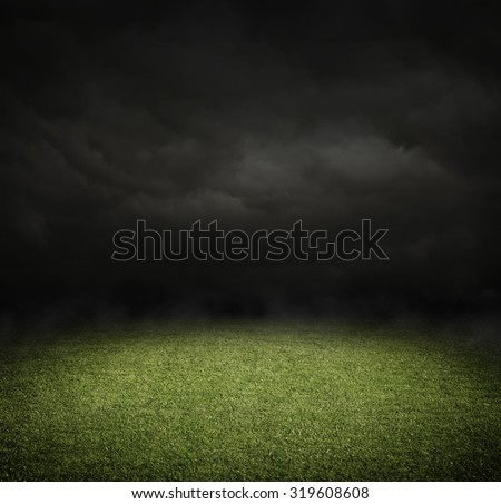 Soccer or football field at night with copy space - stock photo