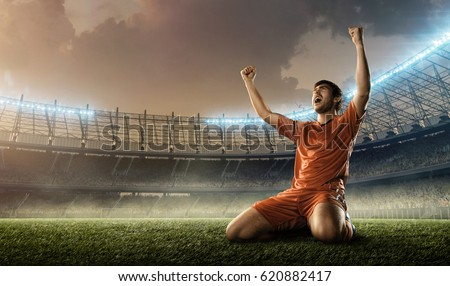 soccer player celebrating goal on a soccer field during the match