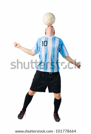 Soccer player control a ball with his head. - stock photo