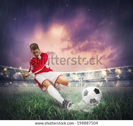 Soccer player during a match in a stadium - stock photo