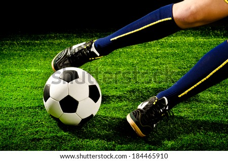 soccer player feet with ball closeup - stock photo