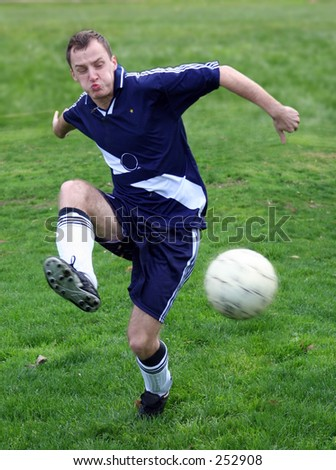 Soccer player hitting a ball