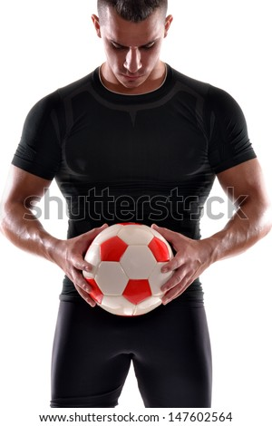 Soccer player holding a soccer ball. - stock photo