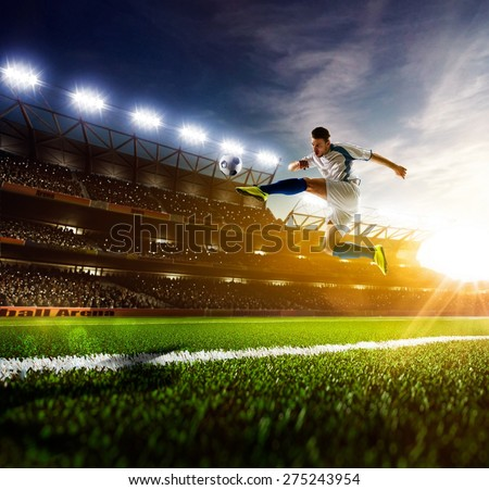 Soccer player in action on sunny stadium background - stock photo