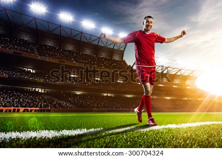 Soccer player in action on sunset stadium background panorama - stock photo
