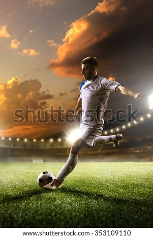 Soccer player in action on sunset stadium with background