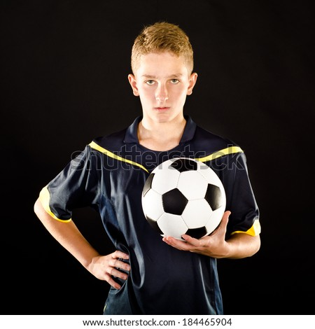 soccer player isolated on a black background - stock photo