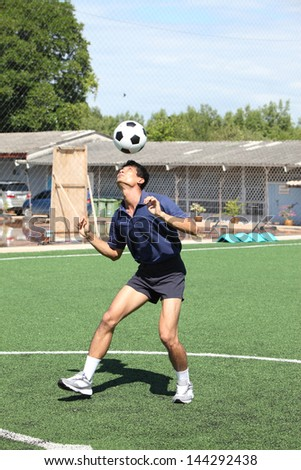 Soccer player juggle the ball  with his head - stock photo